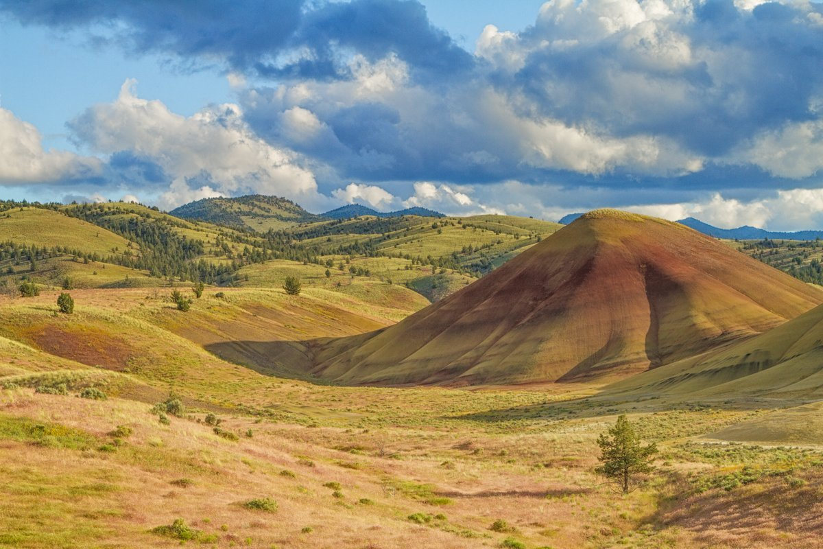 Rolling hills of color and clouds at Painted Hills, Oregon.