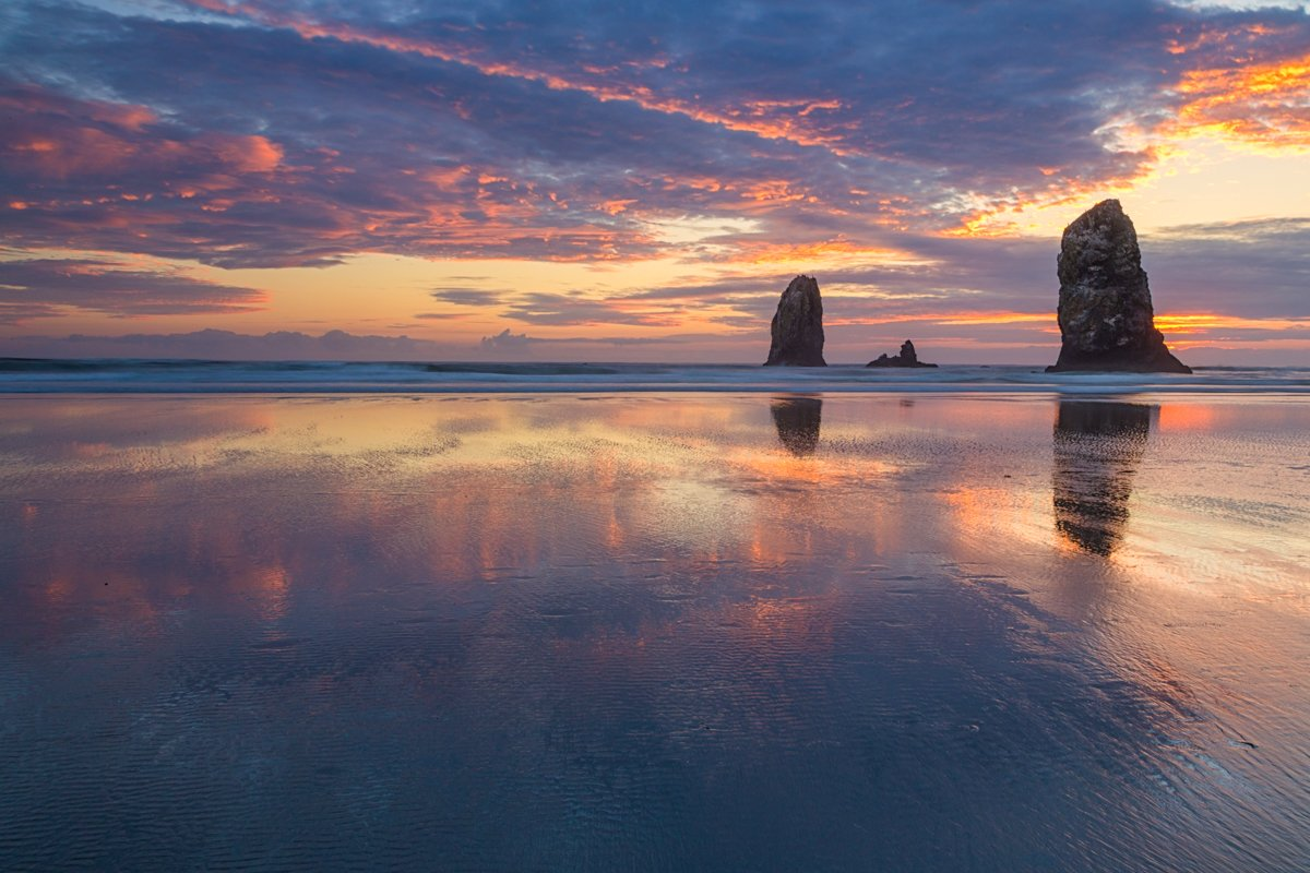 Cannon Beach during colorful sunset.