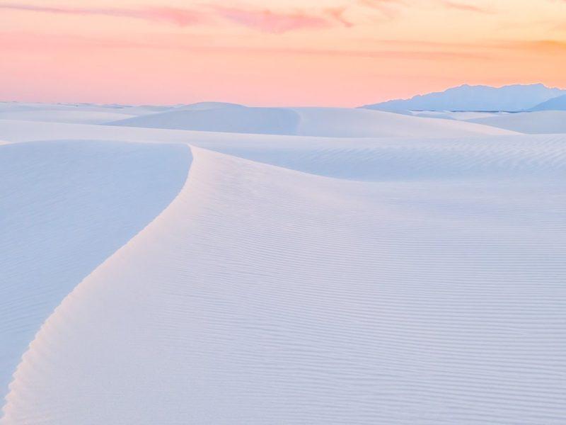 white sand during sunset