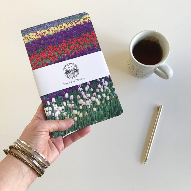 hand holding Tulips Journal